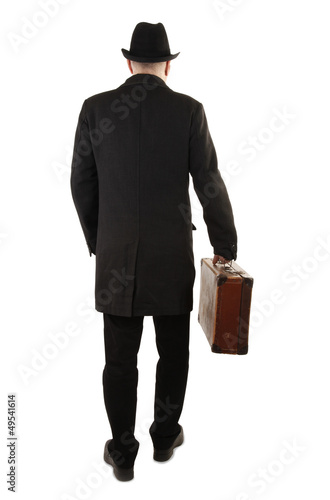 Man with old suitcase rear view