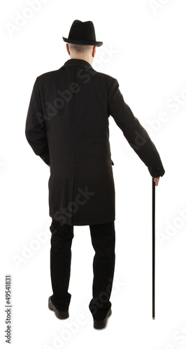 Man with walking stick rear view