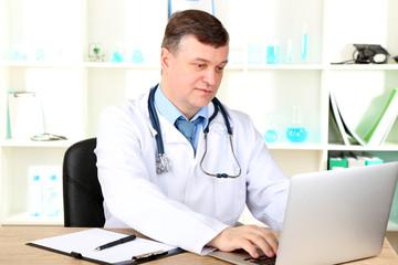Medical doctor working at desk
