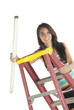 Young woman florescent bulb step ladder