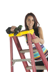 Young woman using tools and step ladder