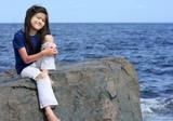 Child enjoying the lakeshore poster