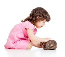 little kid girl playing with cat kitten