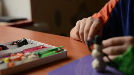 child hands models plasticine. Dolly shot