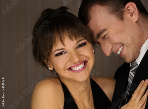 Happy elegant couple in classic dress