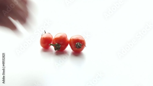 Woman puts tomatoes on  the table. Part 2.