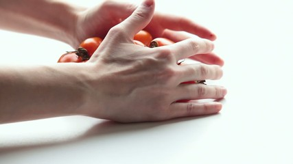 Woman takes tomatoes. Part 2.