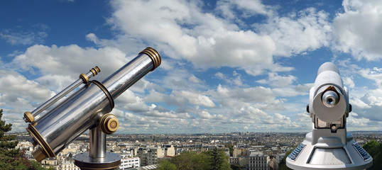 A telescope viewer overlooks view Paris skyline