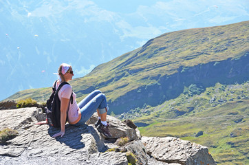 Traveler on the top of a rock. Switzerland