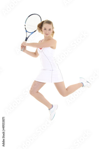 young sporty woman with tennis racket jumping