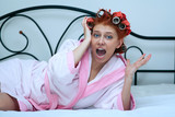 girl in curlers on the bed, the morning