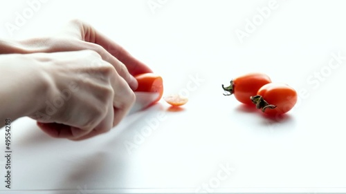 Woman cuts a tomato. Part 3