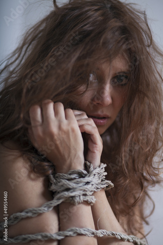 beauty redhaired woman bondage