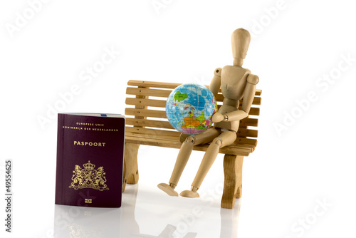 passport globe and man on bench