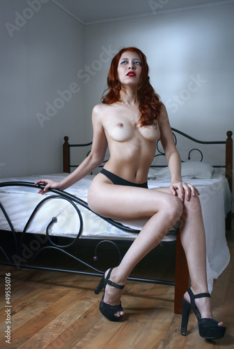Naked girl on the bed