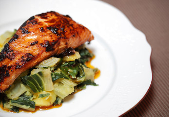 Salmon filet on bed of swiss chard and potatoes
