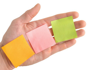 Hand with blank colorful post it notes