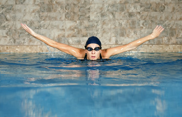 butterfly swimming woman