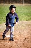 Boy running bases at t-ball practice
