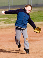 Boy throwing at t-ball practice