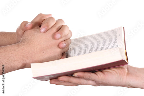 Praying hand hold an open bible