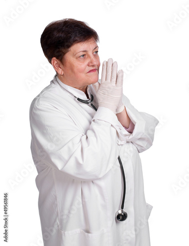 Senior doctor in latex gloves and with stethoscope