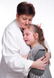 Senior pediatrician calming little girl