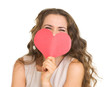 Young woman hiding valentine's day cards