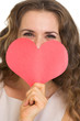 Closeup on young woman hiding valentine's day cards