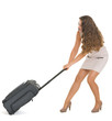 Young traveling woman pulling heavy suitcase on wheels