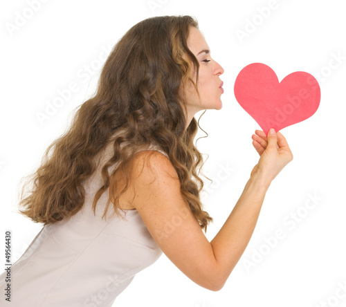 Young woman kissing valentine's day cards