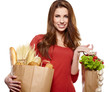 Smiling woman holding a grocery bag
