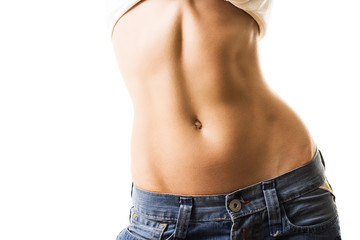 Flat abdomen of young woman in jeans