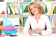 Young beautiful business woman in office at her workplace