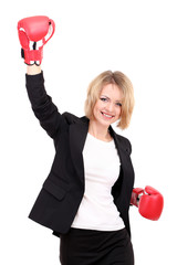 Young beautiful business woman with boxing gloves isolated
