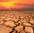 Leinwanddruck Bild - dry and cracked land from natural disaster