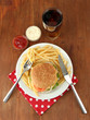 Tasty cheeseburger with fried potatoes and cold drink,