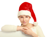 Beautiful christmas woman in santa hat holding