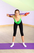 Young woman with skipping rope at gym