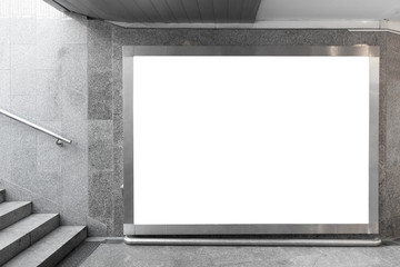 Blank billboard in underground hall