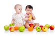 Funny children babies with healthy food fruits isolated on white