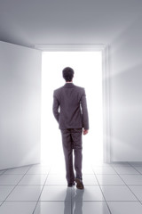Man walking toward open Door