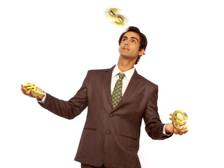 Business man juggling Currency