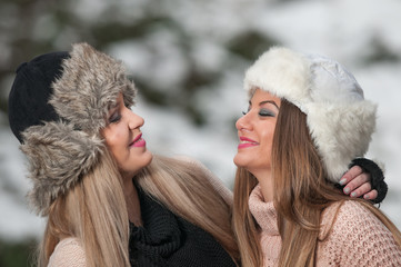 Winter Girls with beautiful make up and snow flake in the forest