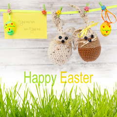 easter eggs, rabbit and flowers hanging on the ribbon
