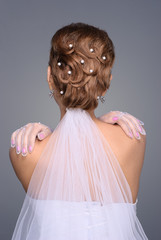 closeup of redhead bride hairstyle in studio