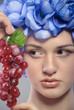 beautiful young girl with red grapes