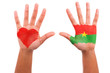 African hands with a painted heart and burkinabe flag, i love  b