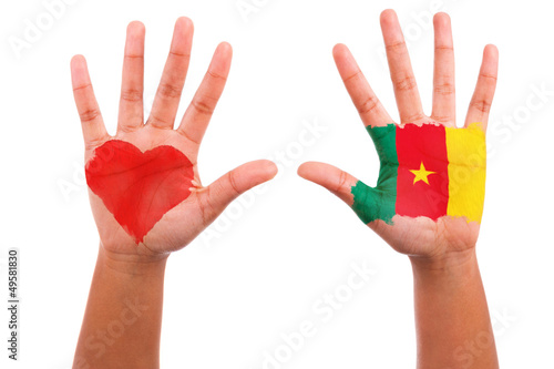 African hands with a painted heart and cameroon flag, i love cam