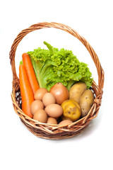 carrot, eggs, onion, poatatoes in a basket